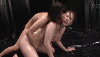 Oily Asian women scissoring after a quick make out session