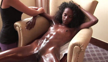 Oiled ebony model and her passionate white girlfriend