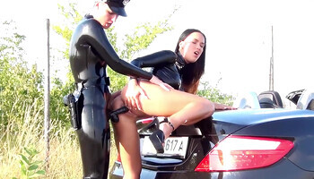 Latex-wearing police officer fucking a random lesbian perp outdoors